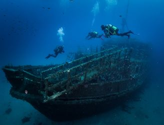 Divers by wreck in St Andrews, Gozo, Malta