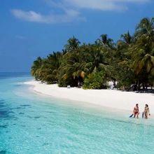 Couple on a beach at Vilamendhoo, the Maldives